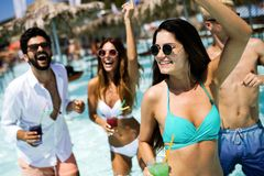 Group of friends having fun on summer vacation. Lifestyle, friendship, travel and holidays concept. Group of friends having fun on summer vacation and drinking stock images