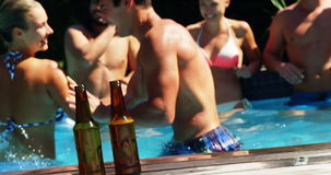 Group of friends having fun in swimming pool stock video