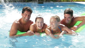 Group Of Friends Having Fun In Swimming Pool Together stock video footage