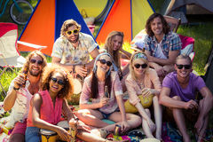 Group of friends having fun together at campsite. Portrait of group of friends having fun together at campsite on a sunny day royalty free stock photography