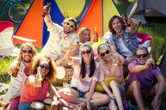 Group of friends having fun together at campsite. Portrait of group of friends having fun together at campsite on a sunny day royalty free stock image