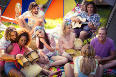 Group of friends having fun together at campsite. On a sunny day stock photography