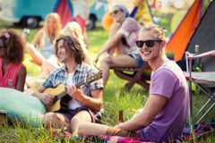 Group of friends having fun together at campsite. On a sunny day royalty free stock photography