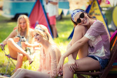 Group of friends having fun together at campsite. On a sunny day stock photo