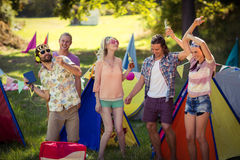 Group of friends having fun together at campsite. On a sunny day stock image