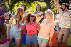 Group of friends having fun together at campsite. On a sunny day royalty free stock images