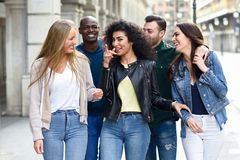 Group of friends having fun together outdoors royalty free stock photography