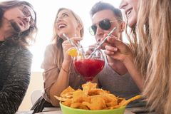 Group of friends having fun togheter drinking stock image