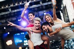 Group of friends having great time on music festival Stock Image