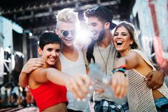 Group of friends having great time on music festival Royalty Free Stock Photo