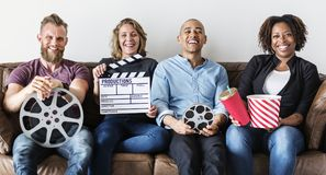 Group of friends having a great time together watching movies royalty free stock photo