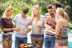 Group of friends having hamburgers and juice Royalty Free Stock Image