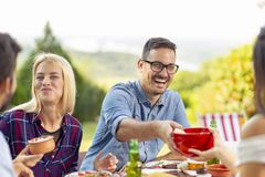 Friends having an outdoor lunch stock photography