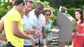 Group Of Friends Having Outdoor Barbeque At Home Royalty Free Stock Photos