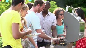 Group Of Friends Having Outdoor Barbeque At Home Stock Images