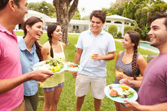 Group Of Friends Having Party In Backyard At Home Royalty Free Stock Photo
