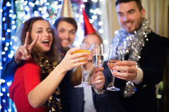 Group of friends having party on New Years Eve. Royalty Free Stock Images