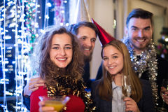 Group of friends having party on New Years Eve. Stock Photo