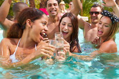 Group Of Friends Having Party In Pool Drinking Champagne Royalty Free Stock Photos