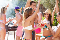 Group Of Friends Having Party By Swimming Pool Stock Photography