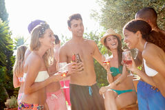 Group Of Friends Having Party By Swimming Pool Stock Photos
