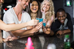 Group of friends having shots Royalty Free Stock Photos