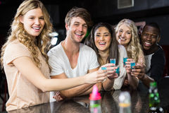 Group of friends having shots Royalty Free Stock Images