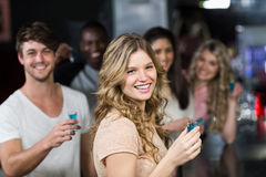 Group of friends having shots Royalty Free Stock Image