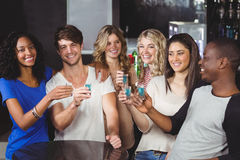 Group of friends having shots Stock Image