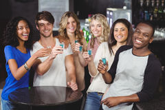 Group of friends having shots stock photography