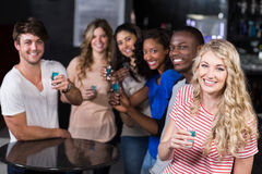Group of friends having shots Royalty Free Stock Photo