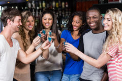 Group of friends having shots Royalty Free Stock Photography