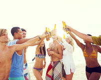 Group of friends having a summer beach party Stock Photos