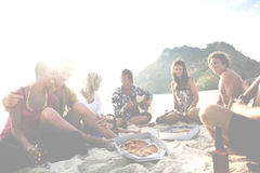 Group of friends having a summer beach party Concept Royalty Free Stock Photos