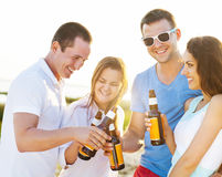 Group of friends having a summer beach party Stock Image