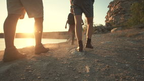 Group of friends hiking on rocky coastline stock footage