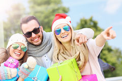 Group of friends holding Christmas presents Royalty Free Stock Images