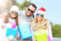 Group of friends holding Christmas presents Stock Photography