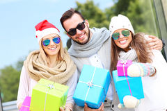 Group of friends holding Christmas presents Royalty Free Stock Photography