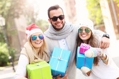 Group of friends holding Christmas presents Stock Images