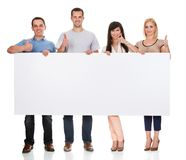 Group of friends holding placard. On White Background Royalty Free Stock Photography