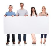 Group of friends holding placard. On White Background Stock Images