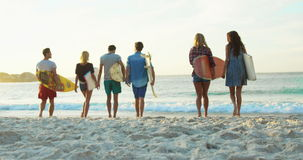 Group of friends holding surfboard stock footage