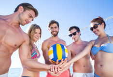 Group of friends holding volleyball Stock Image