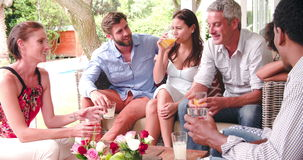 Group Of Friends At Home On Patio Talking Together stock video footage