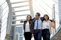Group of friends in a huddle together standing arm in arm royalty free stock photography