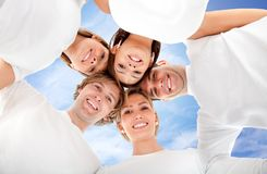 Group of friends hugging Stock Images