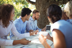 Group of friends interacting with each other. In outdoors restaurant Stock Photography