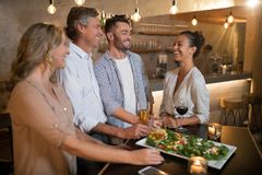 Group of friends interacting with each other. In restaurant Stock Photos