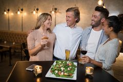 Group of friends interacting with each other. In restaurant Stock Photo